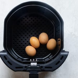 Add the eggs to the fryer basket
