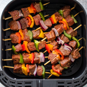 Set the prepared kebabs into the air fryer basket.